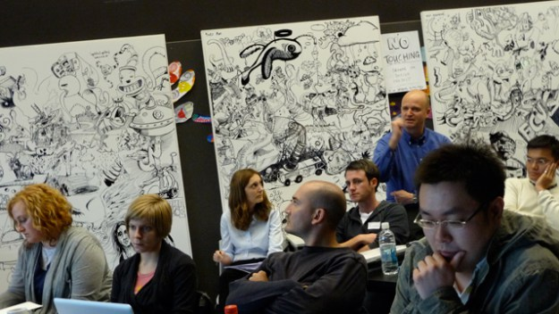 Ralph Schroeder at the back: commenting on a student presentation (SDP2009, Brisbane). Credit: ericcook