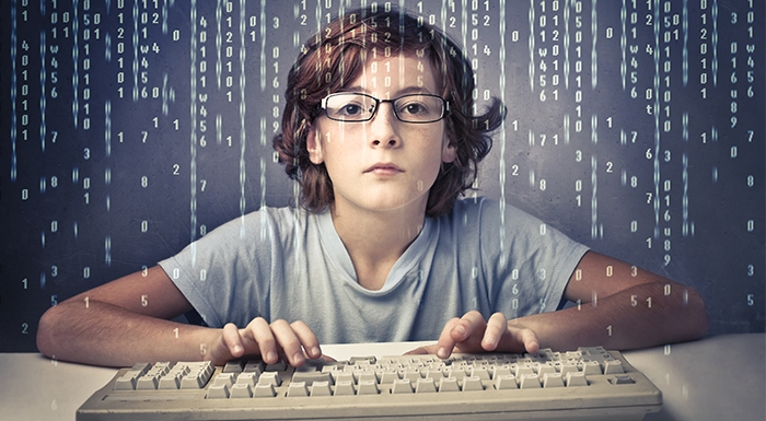 Child with computer keyboard with binary background