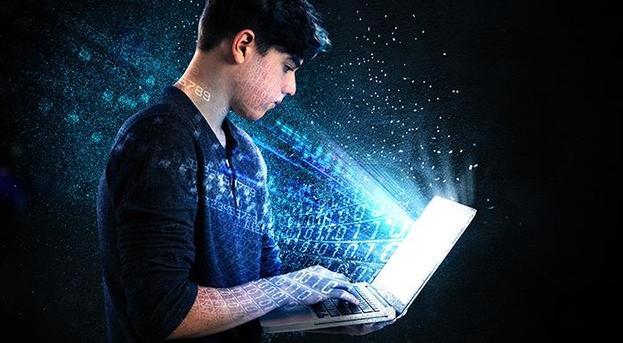 Teenager holding laptop