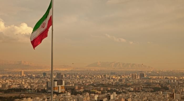 Iran flag over Tehran